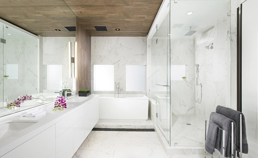 marble-like porcelain tile in the master bathroom