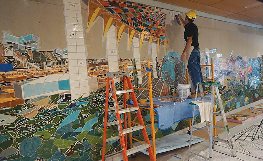 mural features 1964 New York World's Fair